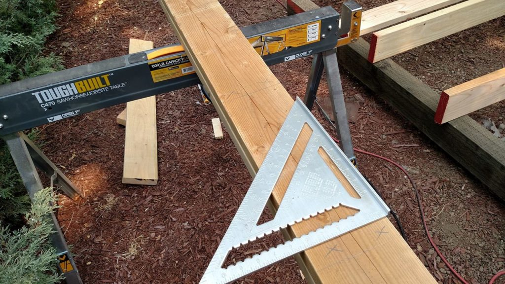 Mark your future joist attachment on the broad side, then flip the triangle and transfer your location precisely onto another joist.