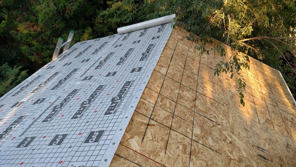 Half the roof is done. The ridge will be wrapped over when the other slope gets finished.