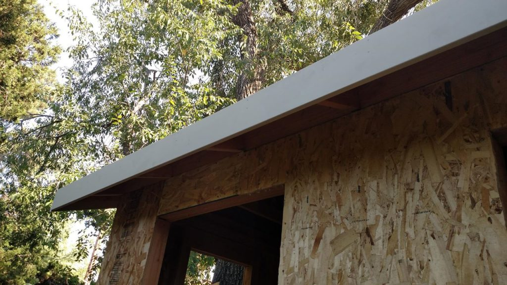 Fascia installed on top of sub-fascia. Make it flush with the sub-fascia, because drip edge goes on top.