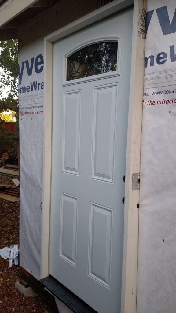 Fitting the door in.
